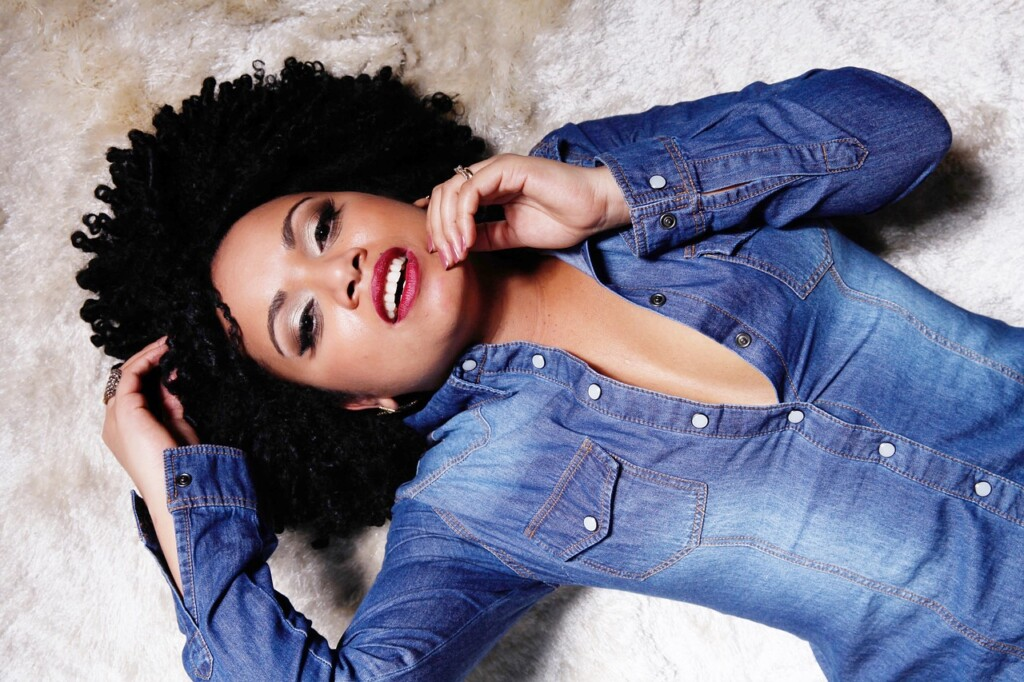 black woman lying on the ground with a seductive look